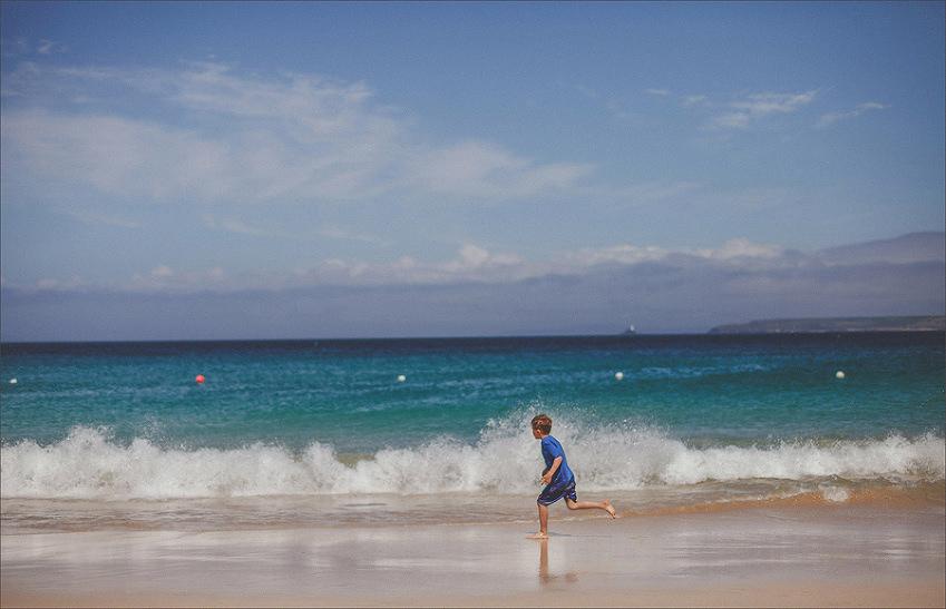 A boy running on a beach