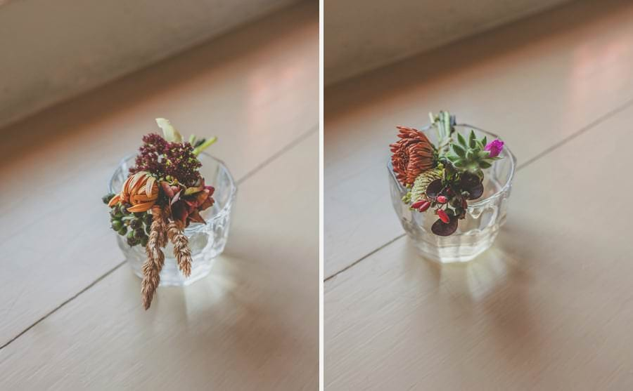 The flowers lay in a glass of water next to the window in the grooms bedroom