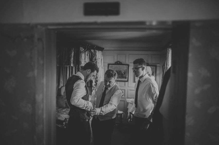 The grooms father and his brother help the groom to get dressed in his bedroom at Maunsel House