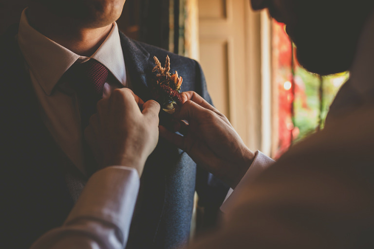 Fixing a flower on the lapel of a suit