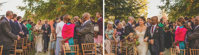 The bride and her father walk up the aisle of the outdoor ceremony at Mausel House