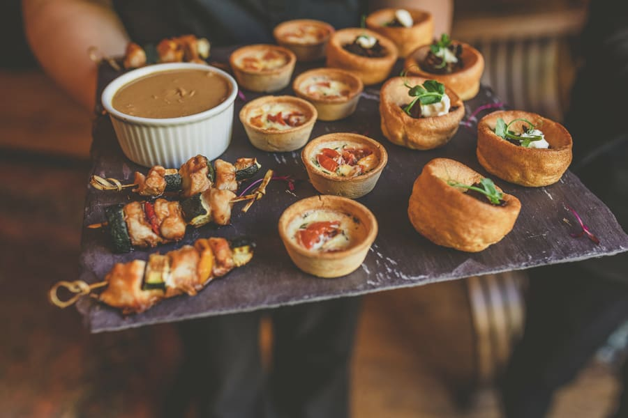 Pastries and canapes on a slate tray at Maunsel house