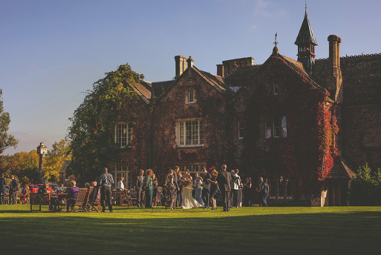 The wedding party on the lawn at the back of Maunsel House after the outdoor wedding ceremony
