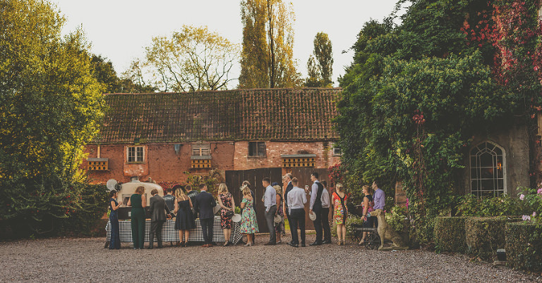 Wedding guests queue outside Maunsel House for food