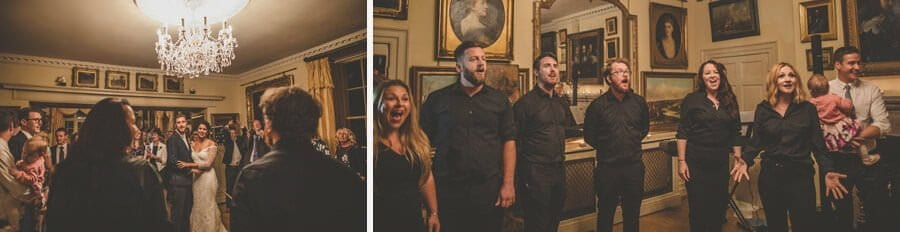 A choir stand in front of the bride and groom and sing in the dining room at Maunsel House