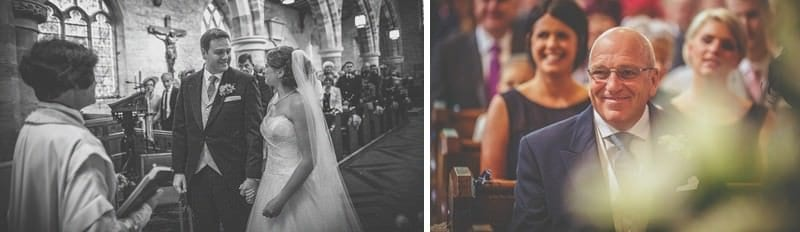 The bride looks at the groom and smiles in St Bartholomews church