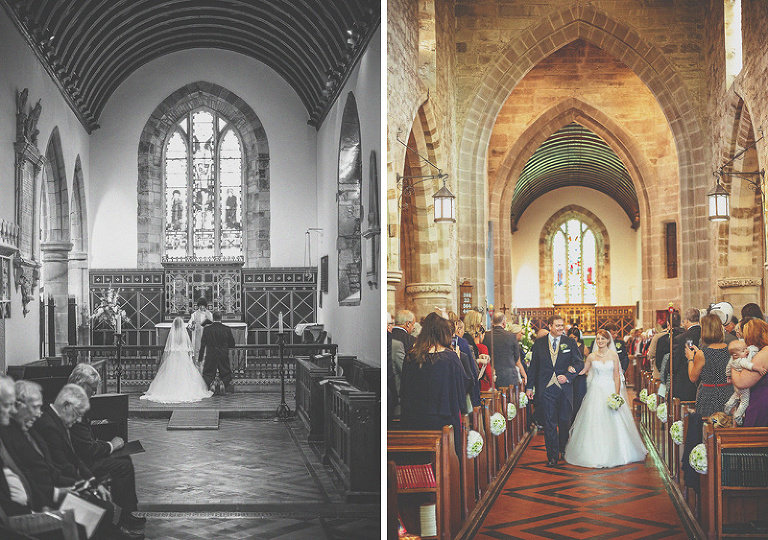 The bride and groom walk down the aisle of the church together