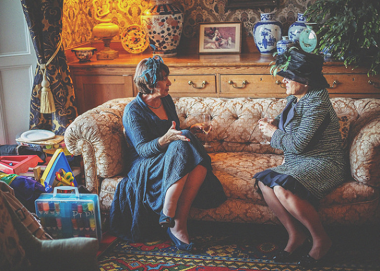 Two ladies sit on a sofa and talk in a room at homme house