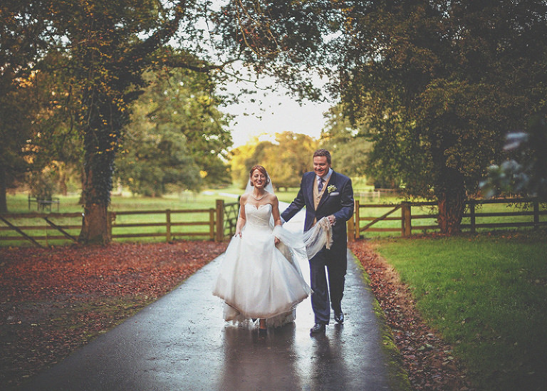 The bride and groom walk through the grounds at homme house
