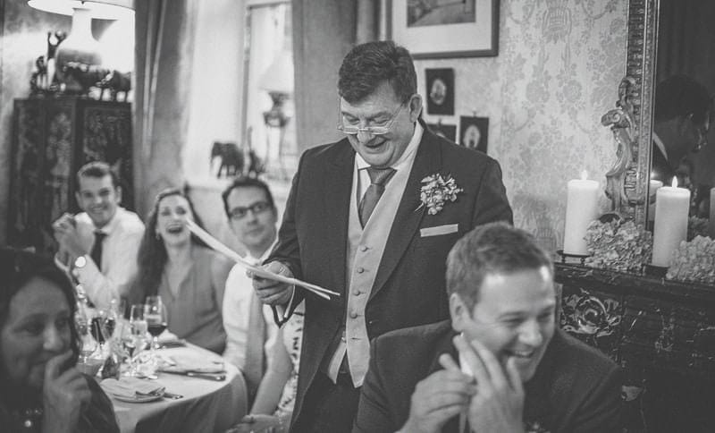 The best man delivers his speech to the wedding party at homme house
