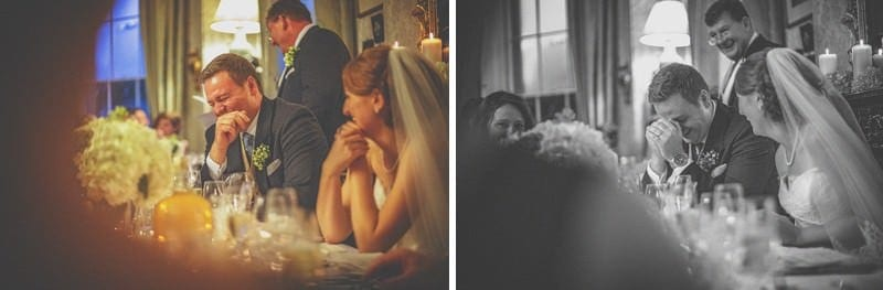 The bride and groom laugh during the best mans speech