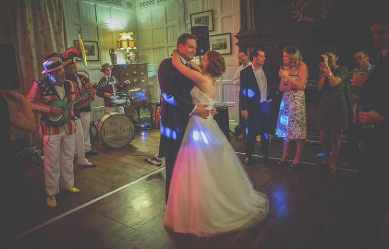 The bride and groom dance together on the dance floor at homme house