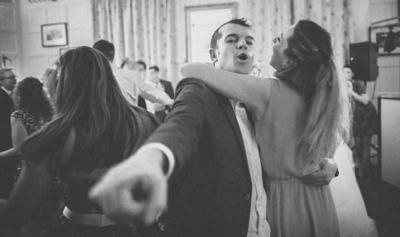 A wedding guest dancing with his fiance at homme house