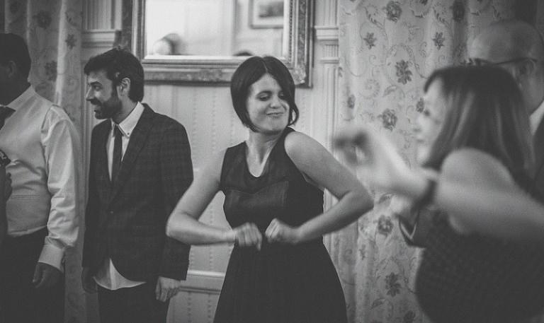 A bridesmaid dances on the dancefloor