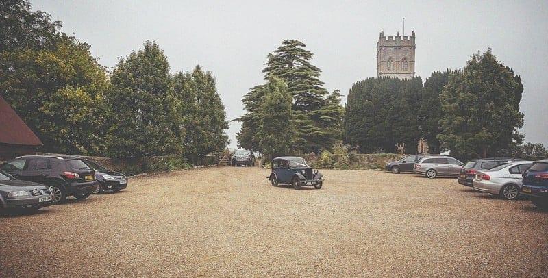 The old vintage car arrives at Muchelney