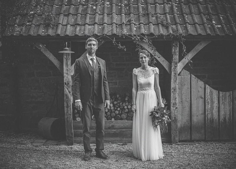The bride and groom outside the barn