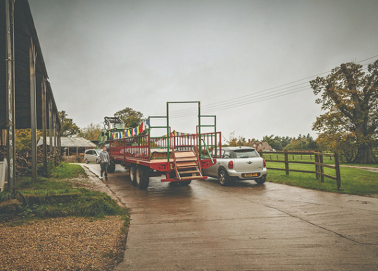 A tractor and trailer wait for the wedding guests