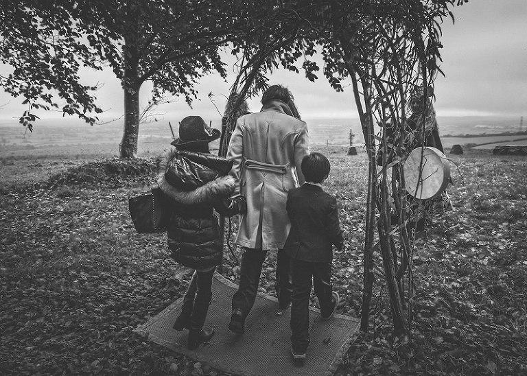 Wedding guests walk towards the stone circle