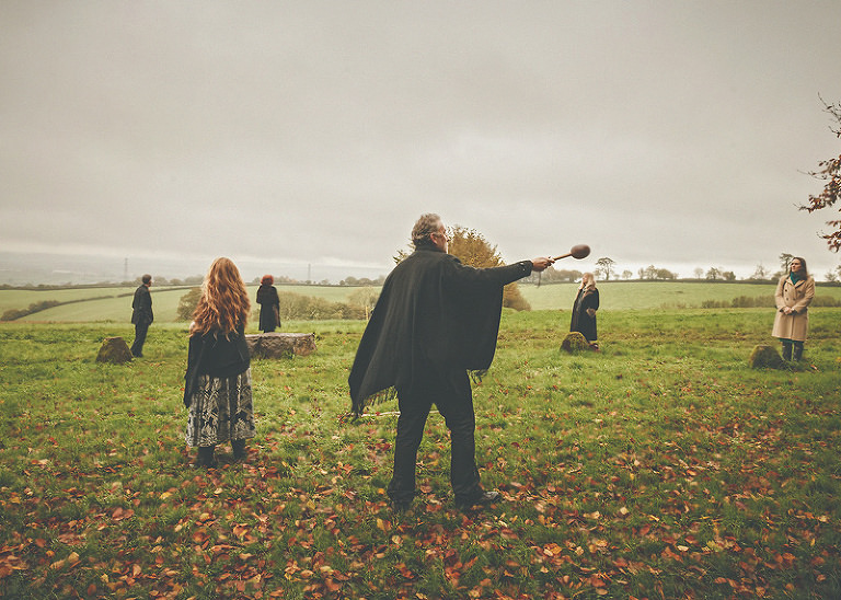 The pagan wedding ceremony begins around the stone circle