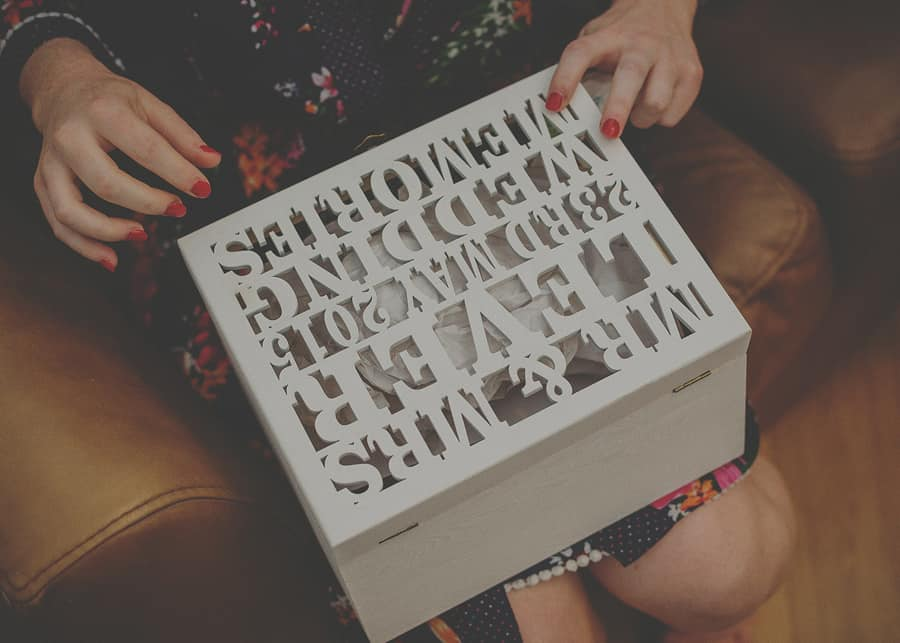 The bride opens her box of gifts