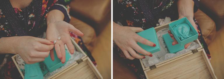 The bride opens a small box