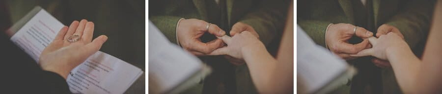 The groom places the wedding ring onto the finger of the bride