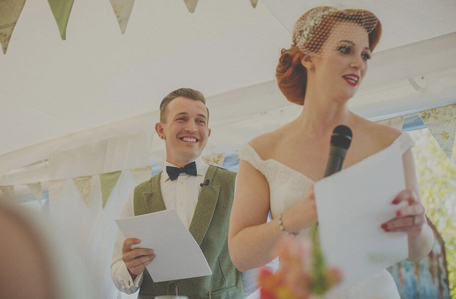 The bride and groom deliver their speech in the marquee at Penmaen house