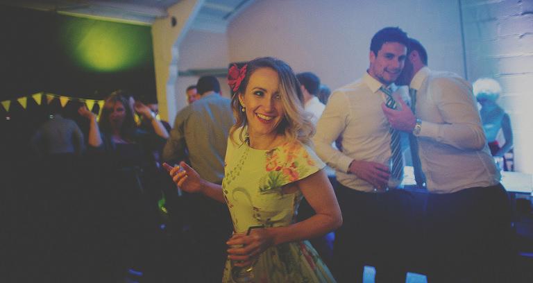 A wedding guest dancing
