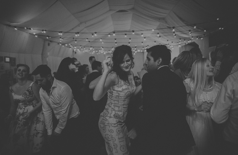 A husband and wife dancing on the dancefloor