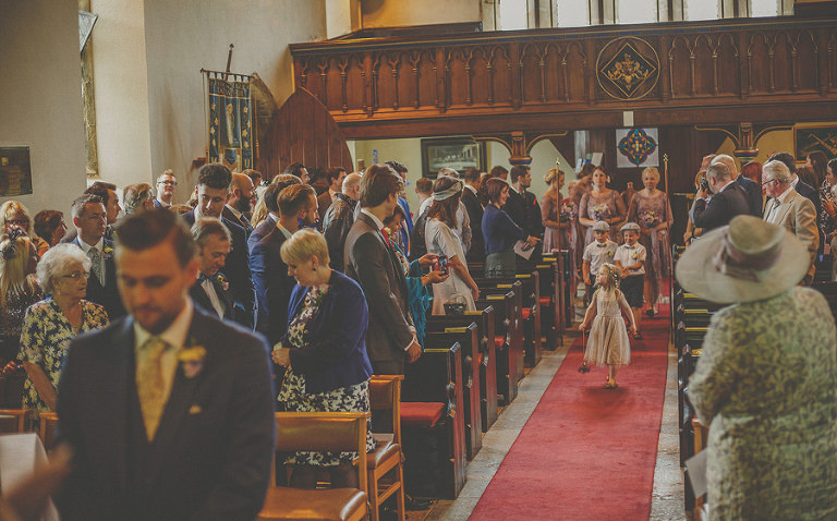 Bridesmaids enter the church