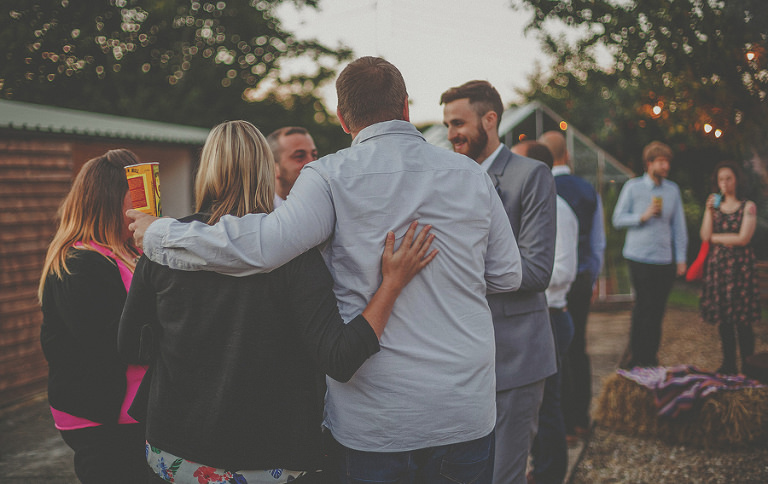 Guests embrace each other outside the bar