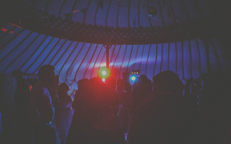 Wedding guests dancing in the yurt