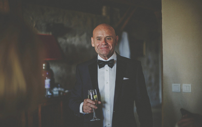The brides father with a glass of champagne
