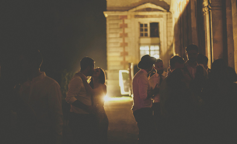 A man and lady kiss in the grounds of Chateau vallery