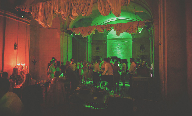 Guests dance in the main hall at chateau vallery