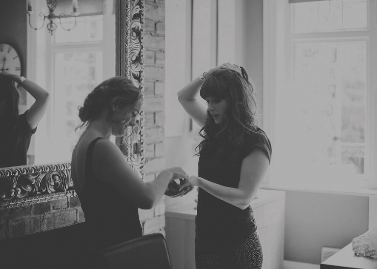 The bridesmaids get ready in the kitchen