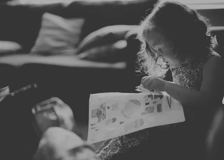 A flowergirl reads her book on the sofa