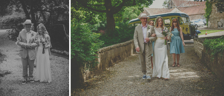 The bride and her father walk across the grounds of Markington Hall