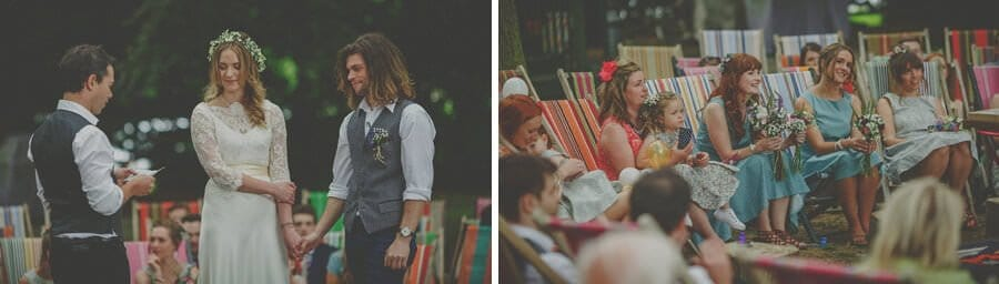 A member of the wedding party reads a speech in front of the bride and groom