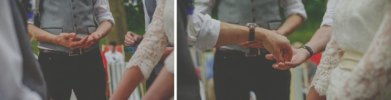 A wedding guest places a ring into the hand of the bride