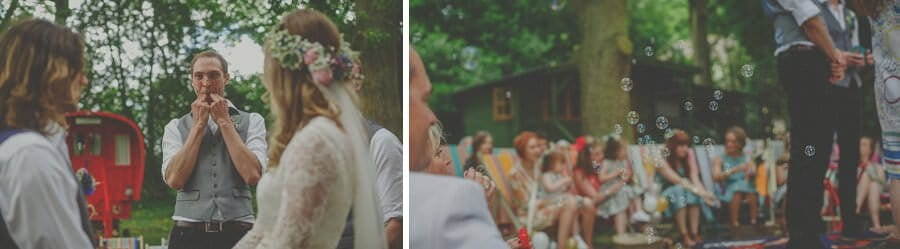 A wedding guest stands in front of the bride and groom and whistles