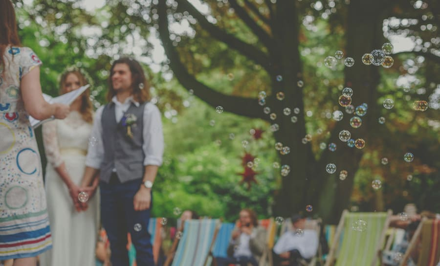 Bubbles float across the air during the wedding ceremony