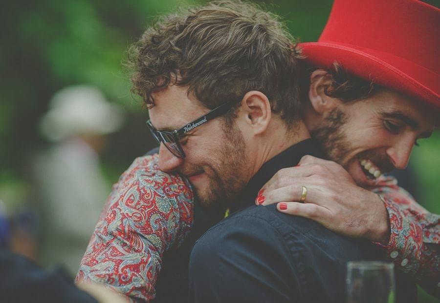 Wedding guests embrace each other