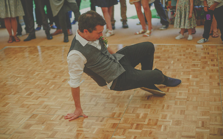 An usher dancing on the dancefloor in the marquee