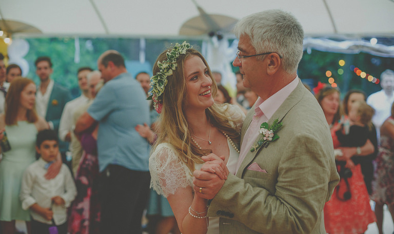 The bride and her father dance together on the dancefloor in the marquee at Markington Hall