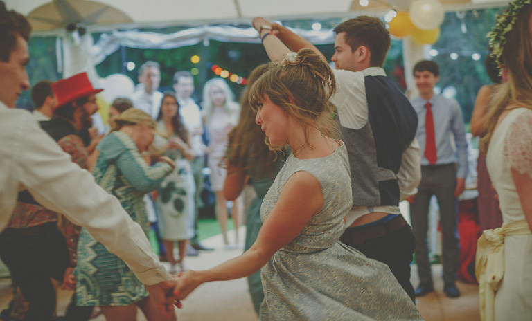A bridesmaid dancing with friends
