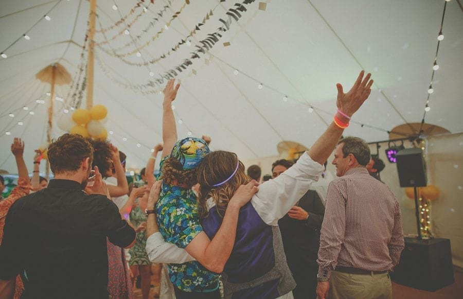 The groom celebrates with a friend in the marquee