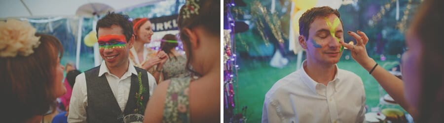 Wedding guests paint their faces in the marquee at Markington Hall