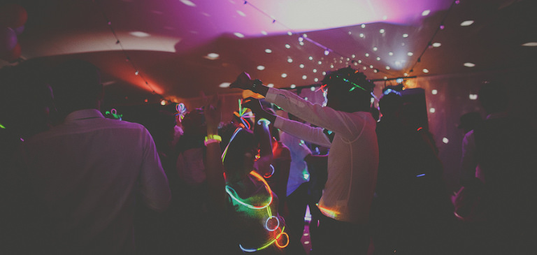 Wedding guests on the dancefloor of the marquee