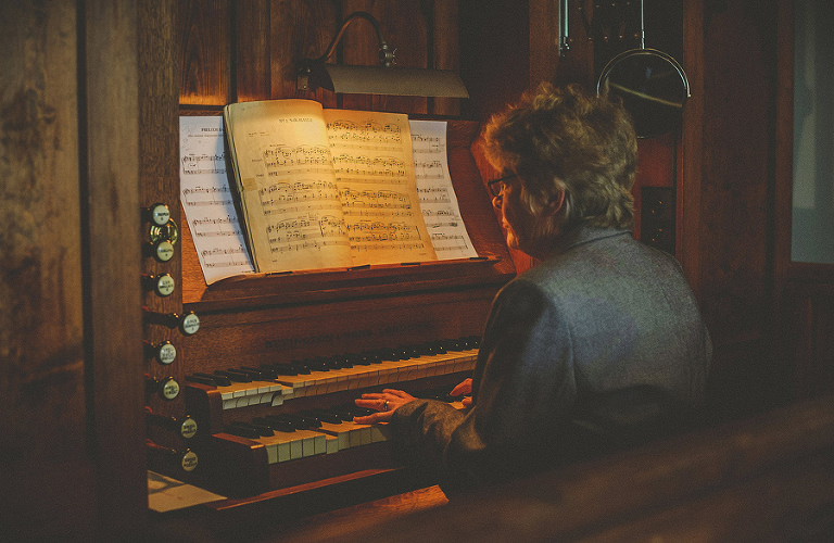 The church pianist plays on the organ